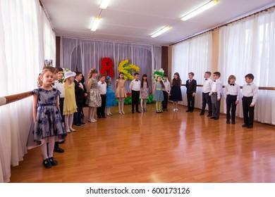 ODESSA, UKRAINE - March 8, 2017: Children at concert in primary school. Skit. Children's theatrical creativity, amateur performance in kindergarten congratulate mothers on Women's Day, Mother's Day.