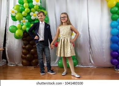 ODESSA, UKRAINE - March 8, 2018: children perform at concert in primary school. Children's theatrical creativity, amateur performance in Kindergarten on Women's Day. Children's creativity