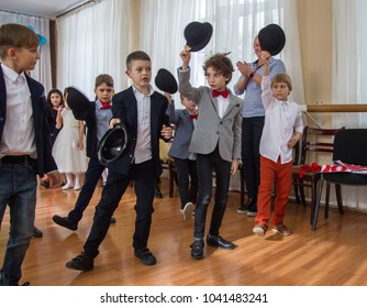 ODESSA, UKRAINE - March 8, 2018: children perform at concert in primary school. Children's theatrical creativity, amateur performance in Kindergarten on Women's Day. Children's creativity