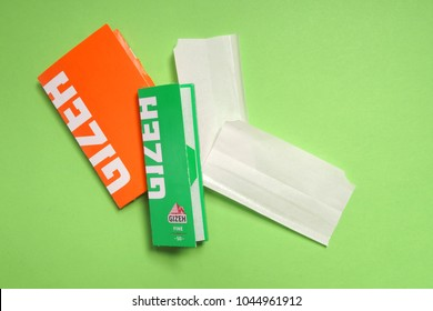 ODESSA, UKRAINE - MARCH 9, 2017:  GIZEH rolling cigarette paper for handmade cigarette with paper sample. GIZEH was founded in 1920 in Cologne and today belongs to the Mignot & De Block