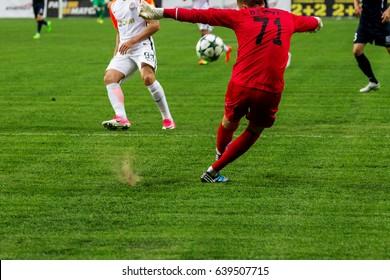 ODESSA, UKRAINE - May 13, 2017: Football League Pari-Match CHERNOMORETS - Odesa takes SHAHTER-Donetsk. Tense game of football rivals on football field of Olympic Stadium