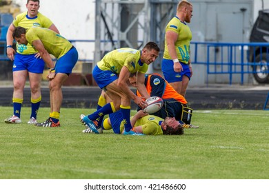 ODESSA, UKRAINE - May 15, 2016: The player suffered a serious injury during a half-cup final rugby in Europe. Rigid sports game Medical Assistance athlete. Ambulance for athletes