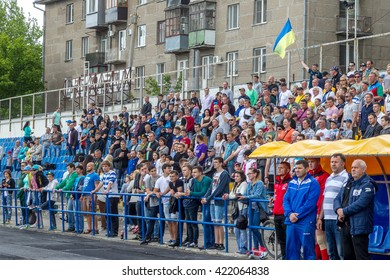 Odessa, Ukraine - may 15, 2016: Spectators and fans in the stands of the stadium during the European Cup rugby. Moldova - Ukraine. Viewers react emotionally to umehi and losing teams in the game.
