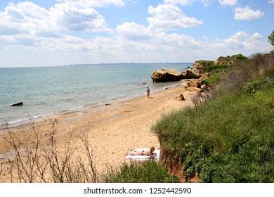 Odessa Ukraine May 15 2018: Beautiful wild Beach Fontanka 2 near Odessa. People relax on the beach on a sunny day
