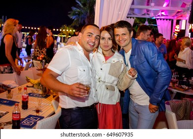Odessa, Ukraine May 17, 2013: Ibiza night club. People make selfy, drink alcohol, dancing, smiling, smoking hookah and kissing during concert in night club party. Man and woman have fun at club