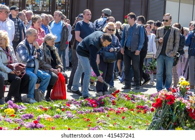 ODESSA, UKRAINE - May 2, 2016: many people Odessans brought flowers to the place of death of people burned alive in the House of Trade Unions, on Memorial Day Tragedy Odessa Khatyn