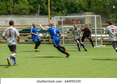 ODESSA, UKRAINE - May 21, 2017: Futsal football players are playing mini football soccer game in an open field of football field for futsal. Intense moment of sports game between players in futsal