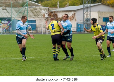 ODESSA, UKRAINE - May 21, 2017: European Rugby Champions Cup UKRAINE (blue) and Sweden (yellow). Rugby ball on field. rugby match is a heavy fight for ball. Rugby players on field