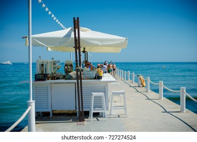 Odessa, Ukraine May 23, 2014: Interior of Elite comfortable beach resort with palm trees and pools. restaurant beach club highest level at resort for holiday in beach season.