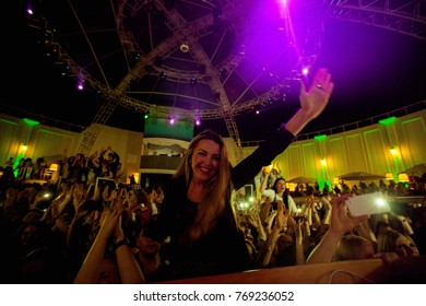 Odessa, Ukraine May 23, 2014: Bono beach club. Women smiling and posing on cam during concert in night club party. Girl have fun at club. girl at night club party