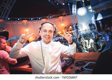 Odessa, Ukraine May 23, 2014: Dj at work in luxury nightclub during night party. Dj make party time at elite night club.