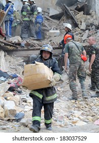 ODESSA, UKRAINE - MAY 23: Residential building destroyed during the earthquake. Rescuers and volunteers and military apart the rubble in search of the living, May 23, 2013 Odessa, Ukraine