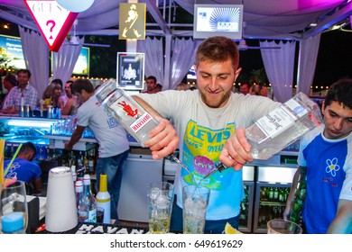 Odessa, Ukraine May 24, 2013: Barman at work in luxury nightclub during night party. Bartender make fun at party time in elite night club