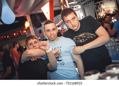 Odessa, Ukraine May 24, 2014: Ibiza club. People smiling and posing on cam during concert in night club party. Man have fun at club. Boy at night club party