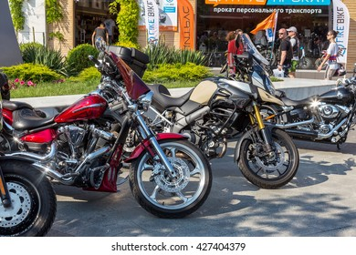 ODESSA, UKRAINE - May 26, 2016: Super Parked bicycles motorcycles exhibited for visitors, beautiful girl at the opening of the traditional biker festival marking the opening of bike season