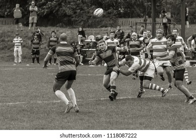 ODESSA, UKRAINE - May 26, 2018: Ukrainian Cup POLITECHNIK - Odessa and CREDO - 65 Odessa (Red). Intense fight of players in rugby for ball. Dynamic game on green field of stadium