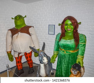 ODESSA, UKRAINE - May 26, 2018: the wax figure of Shrek, princess Fiona (Shreks wife) with Donkey and Puss in Boots at the wax museum Babu Yti.