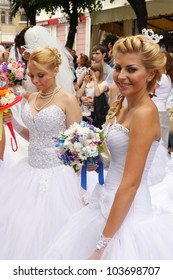 ODESSA, UKRAINE - MAY 27 : Annual event Bride Parade . Happy excited participants in fiancee`s gowns take part in celebration of marriage and romance Bride Parade on May 27, 2012 in Odessa, Ukraine