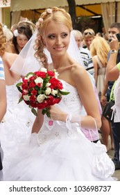 ODESSA, UKRAINE - MAY 27 : Annual event Bride Parade. Happy excited participants in fiancee`s gowns take part in celebration of marriage and romance Bride Parade on May 27, 2012 in Odessa, Ukraine