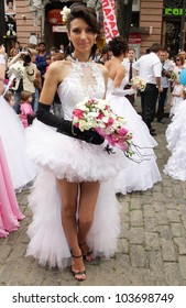 ODESSA, UKRAINE - MAY 27: Annual event Bride Parade. Happy excited participants in fiancee`s gowns take part in celebration of marriage and romance Bride Parade on May 27, 2012 in Odessa, Ukraine