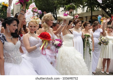 ODESSA, UKRAINE - MAY 27: Annual event Bride Parade . Happy excited participants in fiancee`s gowns take part in celebration of marriage and romance Bride Parade on May 27, 2012 in Odessa, Ukraine