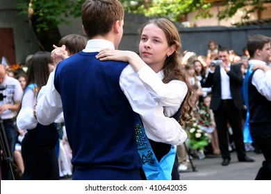 Odessa, Ukraine - May 28, 2010: Last call for school holidays in school yard. Graduates of elementary middle school dance at the ball and release of doves of peace and friendship.