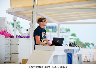 Odessa, Ukraine May 30, 2015: dj playing good music at summer pool party. Day lounge party at luxury summer club. Ibiza dj at work