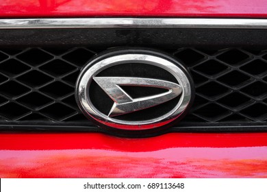 ODESSA, UKRAINE - MAY 7, 2017: Daihatsu company logo and badge on the car. Close up of chromium-plated metal logotype on the dark background. Background with design elements and lines