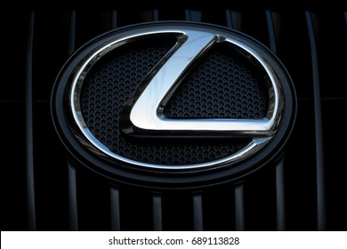 ODESSA, UKRAINE - MAY 7, 2017: Lexus auto logo and badge on the car. Close up of chromium-plated metal logotype on the dark background. Background with design elements and lines