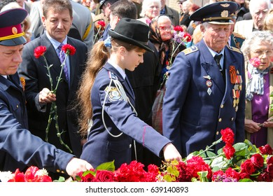 Odessa, Ukraine May 9, 2011: Laying flowers at the monument of the victims of the Second World War.