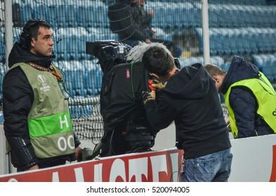 ODESSA, UKRAINE - November 03, 2016: The operator cleans the camera during the UEFA Europa League match group stage Zarya Lugansk vs Feyenoord Rotterdam, Ukraine