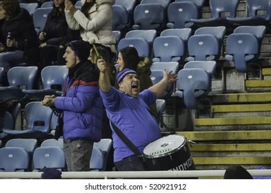 ODESSA, UKRAINE - November 03, 2016: Active fan beats the drum during the UEFA Europa League match group stage Zarya Lugansk vs Feyenoord Rotterdam, Ukraine