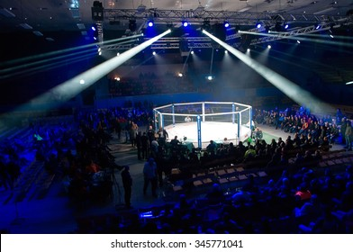 Odessa, Ukraine - November 24: Fight Octagon in the final competition MMA. Fighters come to compete in the cell, resulting in punching, kicking and wrestling. November 24, 2015 in Odessa, Ukraine