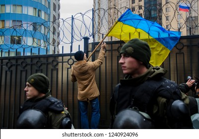Odessa / Ukraine - November 26 2018: Protests of Ukrainian patriots near General Consulate of Russian Federation against aggression of Russia. Protester holding a flag of Ukraine