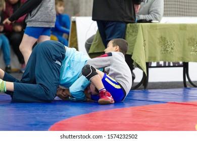 Odessa, Ukraine November 28, 2019: Children's championship of Ukraine freestyle Wrestling. Children's sports, lifestyle. Children's power competitions in martial arts. Greco-Roman freestyle wrestling