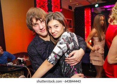 Odessa, Ukraine November 5, 2011: Park night club. People smiling and posing on cam during concert in night club party. Man and woman have fun at club. Boy and girl at night club party