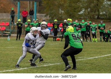 Odessa, Ukraine - November 7, 2015: Ukrainian Cup on American football PIRATES - Odessa and lions - Lions. Tense moment scrum during the match of men. Sport tough fight.