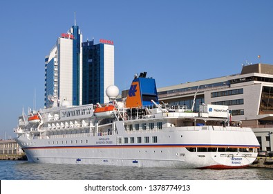 "Odessa / Ukraine - October 08 2014: Expeditionary cruise ship ""BREMEN"" IMO 8907424 of cruise company Hapag-Lloyd Cruises at passenger terminal in port of Odessa"