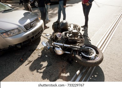 ODESSA, UKRAINE - October 11,2017: an easy accident between car and motorcycle. bike crashed into car. He lost control of  wet asphalt. First aid, police, insurance agent. motorcycle accident with car