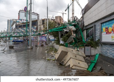 Odessa, Ukraine - October 12, 2016: Strong urban infrastructure damage caused by hurricane. Typhoon, tornado, strong winds overturned crane, ripped electrical wires, destroyed buildings, blocked road
