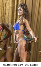 Odessa, Ukraine - October 12: Competitions Ukrainian bodybuilding bodybuilding athleticism of men and women by category on the stage, Ukraine October 12, 2014.