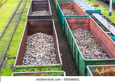 Odessa, Ukraine - October 13, 2016: Heavy industry - coal, metal, square iron pipe is transported in railway freight wagons of the train yard