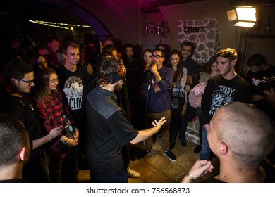Odessa, Ukraine October 14, 2017: Craft Party Bar. Rap Battle at underground club. Man participate in the rep battle with large number of spectators.
