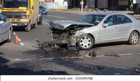 ODESSA, UKRAINE - October 16, 2019: Car accident, head-on collision. A tow truck loads a wrecked car after an accident. Traffic police officer during an investigation in a traffic accident zone