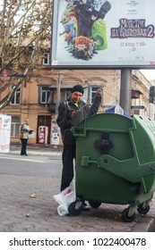 Odessa, Ukraine - October 20, 2015: homeless tramps near garbage cans who are looking for empty bottles and food leftovers. The problem of the homeless. Beggars - unemployed, refugees, emigrants