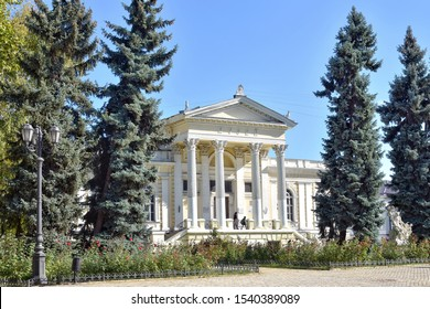 Odessa, Ukraine - October 2019. Facade of Odessa Museum Of Archeology. Magnificent porch with columns in the Museum of Archeology in Odessa with tall fir trees on the front