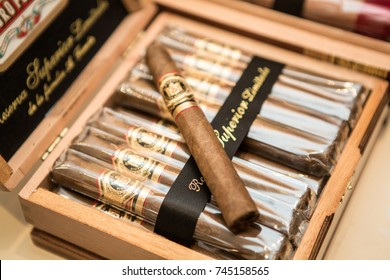 Odessa, Ukraine October 23, 2017: An expensive wooden box with great Dominicana cigars Arturo Fuente. Close up. eft last cigar on brown wooden box