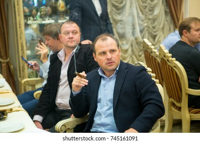 Odessa, Ukraine October 23, 2017: Elegantly dressed men smoking cigars in a luxurious cigar club during cigars club party