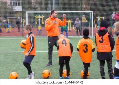 ODESSA, UKRAINE October 26, 2019: FC SHAKHTAR SOCIAL program for development of children's football sports, healthy lifestyles. Younger kick soccer on green futsal field during soccer festival