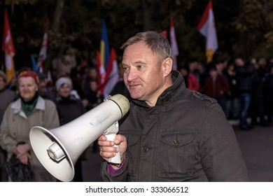 Odessa, Ukraine - October 28, 2015: People on the protests. Protesters shout and carry party flags and slogans, demanding to cancel the results of mayoral election. Civil strife in city